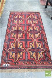Sale 8326 - Lot 1729 - Persian Baluch with six cruciform ornaments in red & blue tone (190 x 110cm)