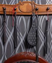 Sale 8761A - Lot 72 - A small group of short whips and a studded paddle