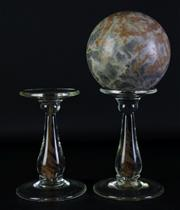 Sale 8960 - Lot 44 - A Large Stone Ball on Glass Stand Together with Another Stand