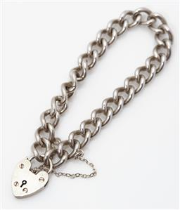 Sale 9123J - Lot 335 - A good heavy vintage sterling silver curb link bracelet with heart shaped clasp, fitted with a safety chain, C: 1970's