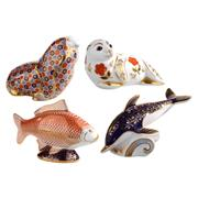 Sale 8000 - Lot 121 - A group of four Royal Crown Derby Imari pattern paperweights comprising a dolphin, carp, sea lion and a walrus.
