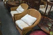 Sale 8331 - Lot 1379 - Set of Four Wicker Chairs with Cushions