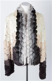 Sale 8550F - Lot 180 - A graduated rabbit fur jacket in honeycomb pattern, size M, together with associated rabbit bobble scarf.
