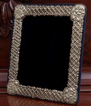 Sale 8595A - Lot 31 - A Victorian silver bordered photo frame, H 32 x W 27cm