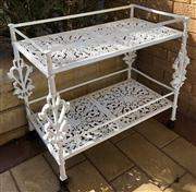 Sale 8774A - Lot 386 - A white painted metal two tiered trolley on wheels