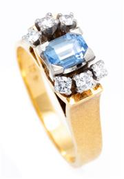 Sale 8915 - Lot 345 - AN 18CT GOLD SAPPHIRE AND DIAMOND RING; centring an emerald cut blue Ceylon sapphire of approx. 0.60ct to upswept shoulders set with...
