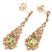 Sale 9083 - Lot 409 - A PAIR OF EDWARDIAN STYLE PERIDOT AND PEARL EARRINGS; elongated drops with leaf motifs set with a pear cut peridot to surround and k...