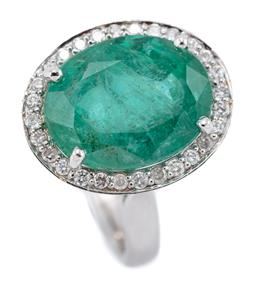 Sale 9123J - Lot 135 - AN 18CT WHITE GOLD EMERALD AND DIAMOND RING; centring an approx. 7.3ct oval cut emerald on an open basket mount to a border of 28 ro...
