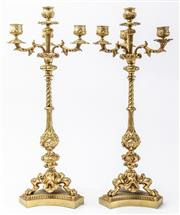 Sale 9083N - Lot 54 - A pair of early C19th ormolu three branch candelabra with tri form bases. Height 47cm