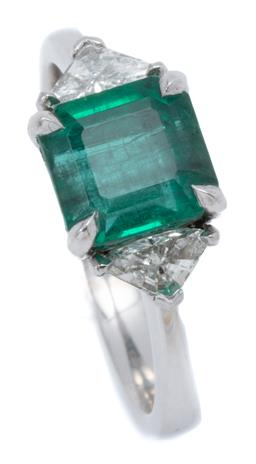 Sale 9124 - Lot 457 - A 14CT WHITE GOLD EMERALD AND DIAMOND RING; claw set with a square emerald cut emerald of approx. 2.00ct flanked by 2 triangular cut...