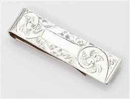 Sale 9123J - Lot 337 - A thick gauge English hallmarked sterling silver money clip, London 2012, the vacant cartouche framed by hand engraved scrolls, L: 52mm