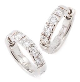 Sale 9140 - Lot 393 - A PAIR OF 18CT WHITE GOLD DIAMOND HOOP EARRINGS BY JAN LOGAN; hinged hoops each set with 4 round brilliant cut diamonds, total diamo...