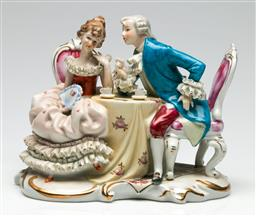 Sale 9209 - Lot 58 - A continental figural group of a lady and gentleman at tea (L:21cm)