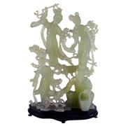 Sale 8000 - Lot 184 - A well carved jadeite figural group depicting a crouched old man with three attendant female figures, on fitted wooden stand.