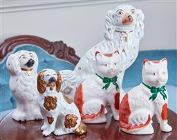 Sale 9103M - Lot 524 - Group of Staffordshire figures including a pair of cats Height 20cm and three dogs in various sizes, Tallest Height 31cm, one chipped.