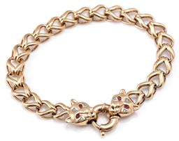 Sale 9128J - Lot 12 - A 9CT GOLD DIAMOND AND GEMSET BRACELET; in the Cartier style twin leopard head terminals set with round cut synthetic ruby eyes and...