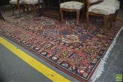 Sale 8335 - Lot 1081 - Fine Large Vintage Bakhtiari Wool Carpet, the lattice frame filled with firs, willows, roses & grapes, on a red field (350 x 287 cm)