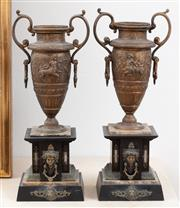 Sale 9070H - Lot 140 - A pair of spelter classical form twin handled urns on marble pedestals with female mask applications, Height 49cm
