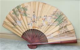 Sale 9190H - Lot 349 - An oversized fan decorated on paper with ladies in a landscape, some damage, Length 40cm