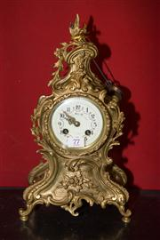 Sale 7962B - Lot 77 - C19th French rococo style brass mantel clock signed A D Mouginn, with key and pendulum
