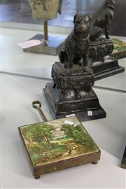 Sale 8189 - Lot 29 - Bronze Figure of a Dog on Cushion with a Ceramic Country Scene Panel