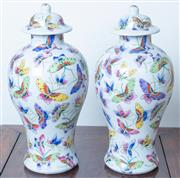 Sale 8800 - Lot 129 - A pair of polychrome baluster lidded vases, with butterfly decoration, H 30cm