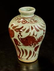 Sale 8536 - Lot 77 - A small glazed Oriental baluster form vase decorated with crimson coloured fish amongst reeds, H 13.5cm