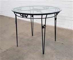 Sale 9151 - Lot 1432 - Metal based garden table with a glass top (Dia 95cm Height 77cm