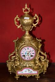 Sale 7962B - Lot 48 - C19th French Gilt and porcelain mantelclock in pink with birds and floral motif, key and pendulum