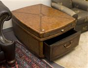 Sale 8310A - Lot 59 - A leather effect suitcase form coffee table, with leather and brass handles and drawer, H 56 x W 108 x D 78cm