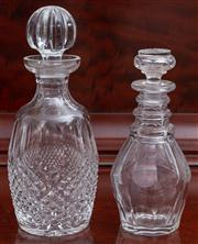 Sale 8595A - Lot 36 - Two cut crystal decanters, to include a barrel form together with a smaller example, larger H 27cm
