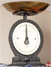 Sale 8926K - Lot 92 - A cast iron and brass salter kitchen scales, H 32cm