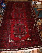 Sale 8080A - Lot 19 - A Western Persian woollen runner with three medallions in red and black tones. 257 x 125cm