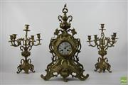 Sale 8508 - Lot 26 - Brass Clock Garniture with a French Style Movement