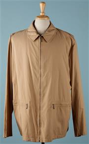 Sale 9080F - Lot 12 - A BURBERRY BLOUSON; in milk chocolate colour with zip up pockets to front , size XL small hole to front