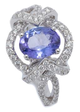 Sale 9123J - Lot 138 - AN 18CT WHITE GOLD TANZANITE AND DIAMOND RING; centring an oval cut tanzanite of approx. 1.21ct to surround shoulders and applied ch...