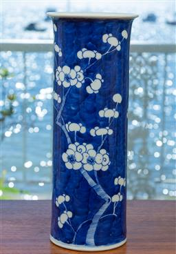 Sale 9164H - Lot 71 - A cylindrical blue and white vase featuring cherry blossom branches, Height 30.5cm