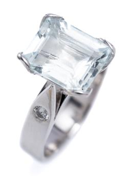 Sale 9194 - Lot 394 - AN 18CT WHITE GOLD AQUAMARINE AND DIAMOND RING; set with an emerald cut very pale aquamarine of approx. 3.62ct to shoulders set with...