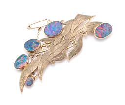 Sale 9221 - Lot 344 - A VINTAGE 9CT GOLD OPAL BROOCH; stylised textured gum leaves design collet set with 5 oval opal triplets, size 83 x 37mm, with safet...