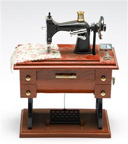Sale 9253 - Lot 280 - A small toy sewing machine (W:17cm)
