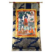 Sale 8000 - Lot 326 - A Tibetan prayer thangka painted with three Buddhist llamas in a forest clearing.
