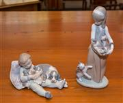 Sale 8368A - Lot 37 - Two Lladro figures, one boy with puppies, the second girl with kittens, H of tallest 24cm