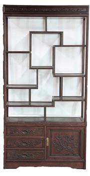 Sale 8913 - Lot 83 - Chinese Carved Rosewood Display Shelf, in three sections, with carved birds & plum blossom cornice, asymetrical shelves, above three...