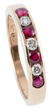 Sale 8974 - Lot 306 - A 9CT GOLD RUBY AND DIAMOND RING; channel set with 4 round cut rubies and 3 round brilliant cut diamonds, size N, wt. 2.14g.
