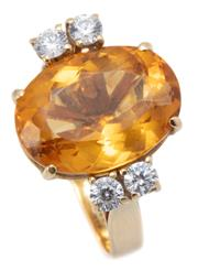 Sale 9037 - Lot 336 - A VINTAGE 18CT GOLD CITRINE AND STONE SET COCKTAIL RING; claw set with an oval citrine of approx. 6.10ct between shoulders set with...