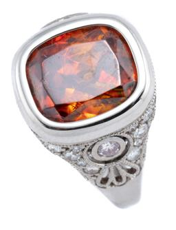 Sale 9123J - Lot 139 - A PLATINUM DIAMOND AND STONE SET RING; centring a cushion cut faceted Mexican fire opal (11 x 9mm) to deco style shoulders and scrol...
