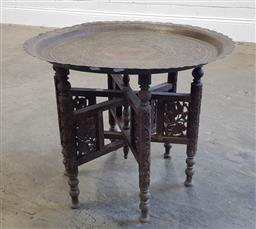 Sale 9183 - Lot 1028 - Round brass top folding Indonesian style side table depicting peacock (h50 x d58cm)