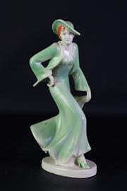 Sale 8923B - Lot 15 - A Deco style ceramic figure of a redhead in a green outfit. Height 30cm