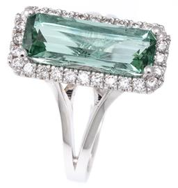 Sale 9124 - Lot 427 - AN 18CT WHITE GOLD TOURMALINE AND DIAMOND RING; featuring a long radiant cut blue green (possibly pariabia) tourmaline of approx. 2....