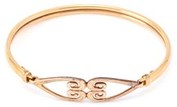 Sale 9164J - Lot 525 - A 9CT GOLD BANGLE; top feature 2 opposing open scroll hearts on a hook clasp, width at top 10mm, bangle width 4mm, internal width 57...